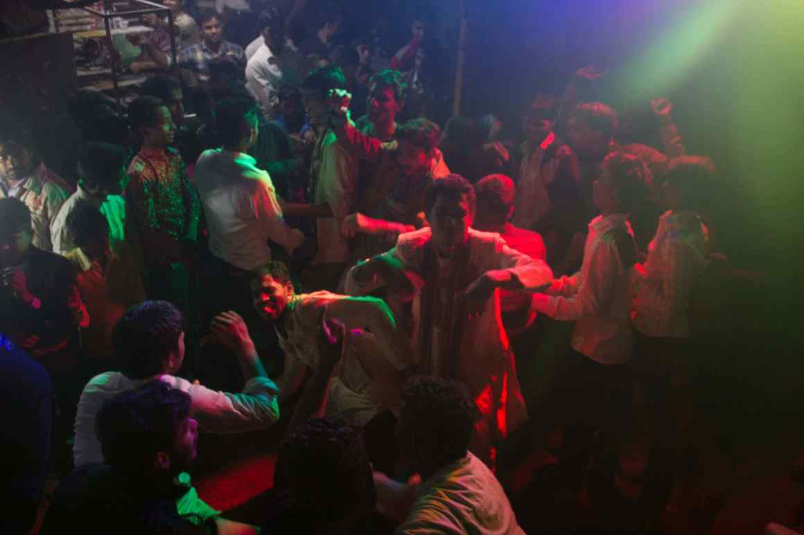 Young residents of Bhatla House dance at a wedding party as DJ Shaffique's music plays on Credit: Nabeela Paniyath/The Wire