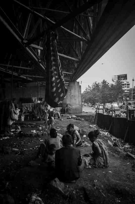 Members of the community living under Amar Mahal flyover. Credit: Prthvir Solanki