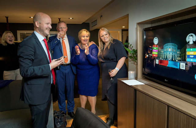 Norway's Prime Minister Erna Solberg, her daughter Ingrid Solberg Finnes and Sgbjorn Aanes, Solberg's advisor react on the good results of Solberg's Conservative party Hoyre in Oslo, Norway September 11, 2017. Credit: Reuters