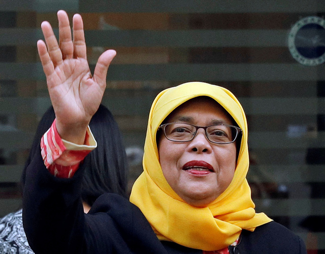 Former speaker of Singapore's parliament, Halimah Yacob, arrives at the Elections Department after she was given the certificate of eligibility to contest the election by the Presidential Elections Committee in Singapore September 11, 2017. Credit: Reuters