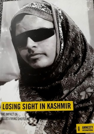 Insha Mushtaq on the cover of the Amnesty report. Credit: Mudasir Ahmad