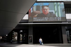 A passerby walks under a TV screen reporting news about North Korea's missile launch in Tokyo, Japan September 15, 2017. Credit:Reuters/Issei Kato