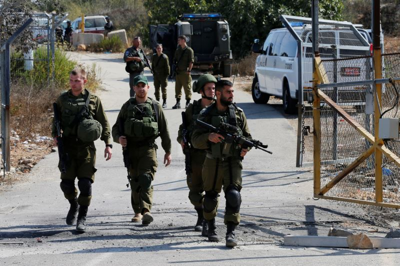 Israeli soldiers guard near the scene where a police spokeswoman said a Palestinian gunman killed three Israelis guards and wounded a fourth in an attack on a Jewish settlement in the occupied West Bank before himself being shot dead, September 26, 2017. Credit: Reuters/Ammar Awad