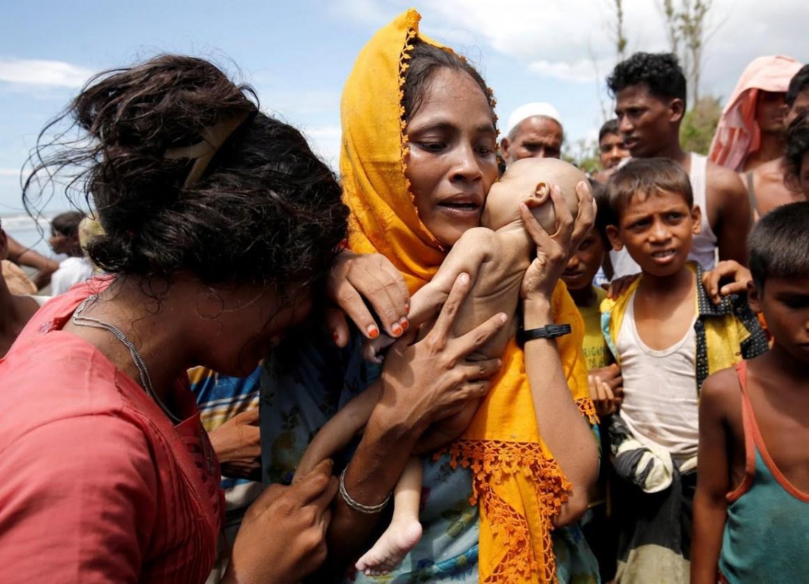 Hamida with her baby's body. Credit: Mohammad Ponir Hossain/Reuters