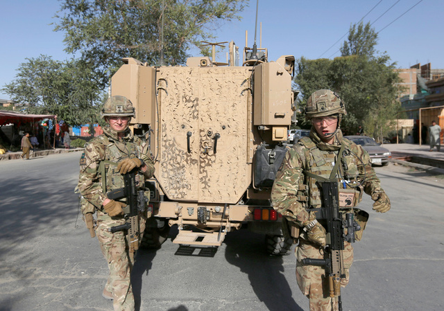 NATO soldiers arrive at the site of a suicide attack followed by a clash between Afghan forces and insurgents after an attack on a Shi'ite Muslim mosque in Kabul, Afghanistan, August 25, 2017. Credit: Reuters