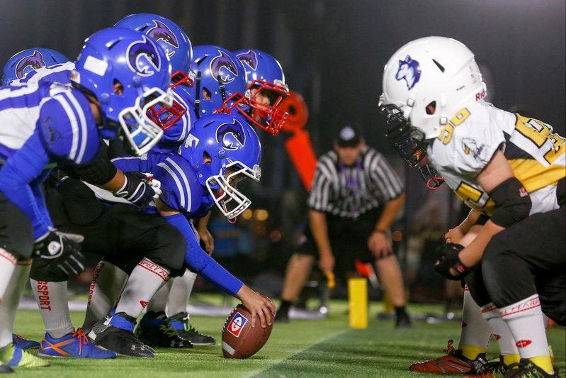 The Sharklets (blue shirts) play the Eagles in a Future League American football youth league match in Beijing, China, May 26, 2017. Credit: Reuters