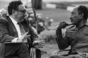 'You can never, in American public life, underestimate the advantages of complete and total incomprehensibility.' Kissinger meets Anwar Sadat in 1976. Credit: Wikipedia