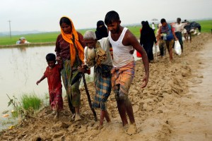 Rohingya refugees walk on the muddy path after crossing the Bangladesh-Myanmar border in Teknaf, Bangladesh, September 3, 2017. Credit:Reuters