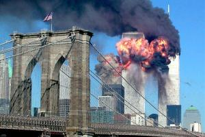 The second tower of the World Trade Center bursts into flames after being hit by a hijacked airplane in New York in this September 11, 2001 file photograph. Al Qaeda leader Osama bin Laden was killed in a firefight with U.S. forces in Pakistan on May 1, 2011, ending a nearly 10-year worldwide hunt for the mastermind of the Sept. 11 attacks. The Brooklyn bridge is seen in the foreground. Credit:Reuters