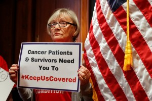 A woman holds a sign during a press conference held by U.S. Sen. Bob Casey, D-Pa., to speak out against the latest Republican effort to repeal Obamacare on Capitol Hill in Washington, U.S., September 25, 2017. Credit: Reuters