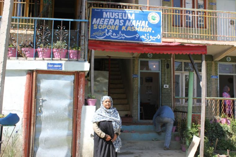 Atika Bano standing outside the Meraas Mahal museum in Sopore. Credit: Bhavneet Kaur