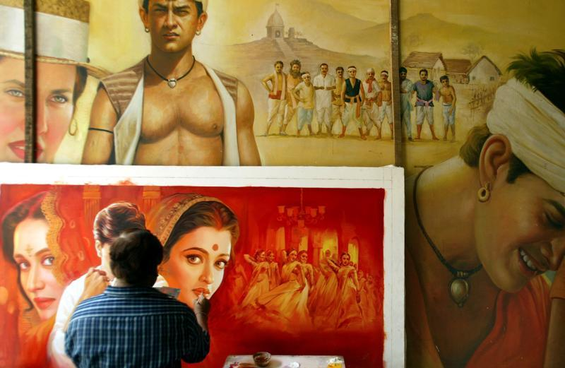 An Indian artist paints a Bollywood film poster at a workshop in Bombay April 29, 2005. Credit: Reuters/Punit Paranjpe