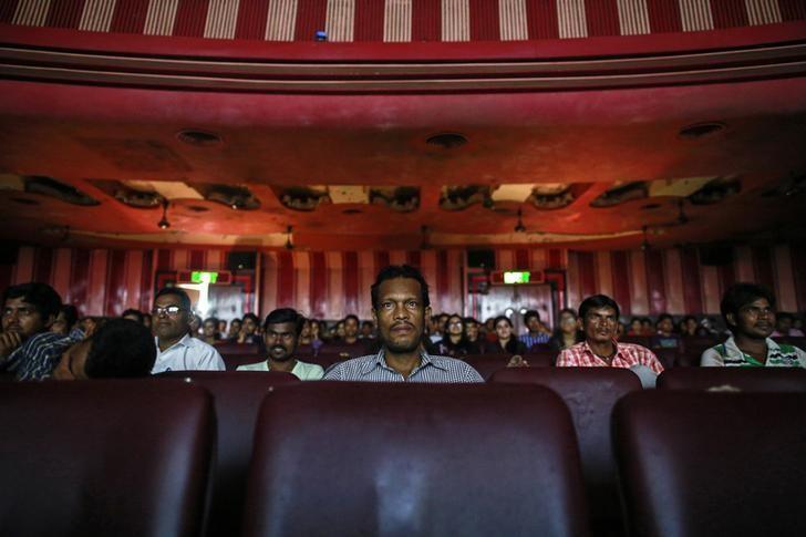 Cinema goers watch a Bollywood movie inside Maratha Mandir theatre in Mumbai December 11, 2014. Credit: Reuters/Danish Siddiqui/Files