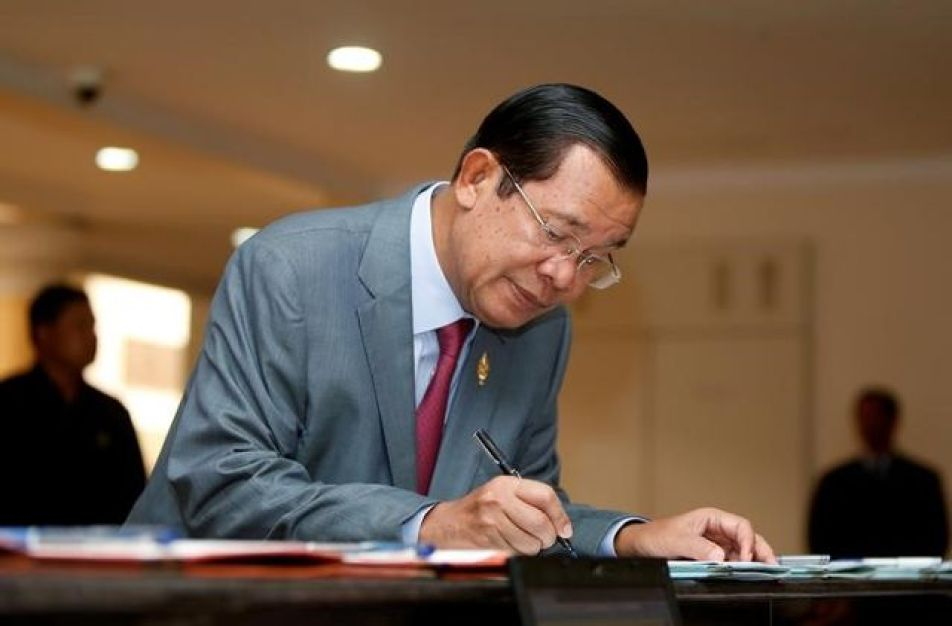 Cambodia's Prime Minister Hun Sen registers as he arrives before a plenary session at the National Assembly of Cambodia in central Phnom Penh, October 16, 2017. Credit: Reuter