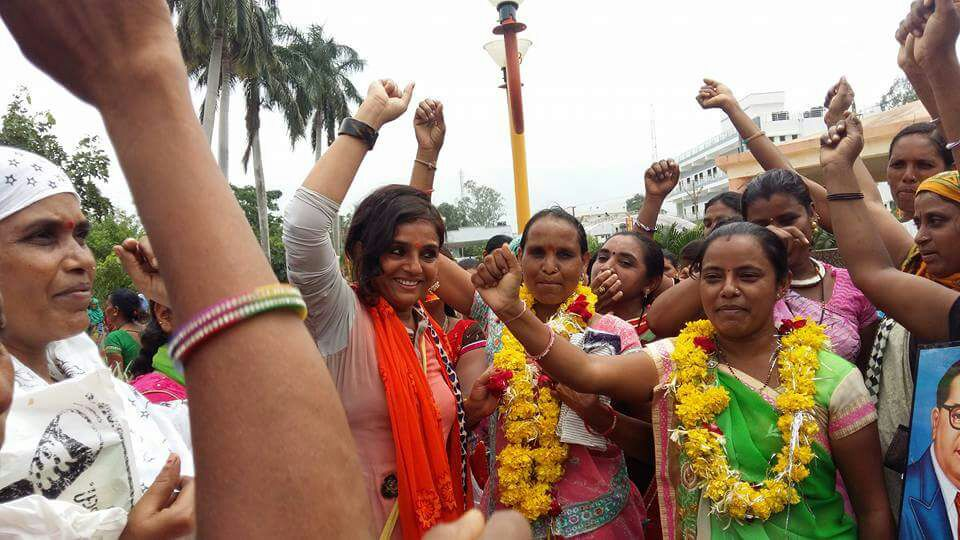 Chandrika Solanki (in red dupatta) being welcomed after she was released. Credit: Damayantee Dhar
