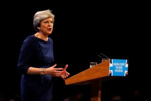 Britain's Prime Minister Theresa May addresses the Conservative Party conference in Manchester, October 4, 2017. Credit: Reuters/Phil Noble