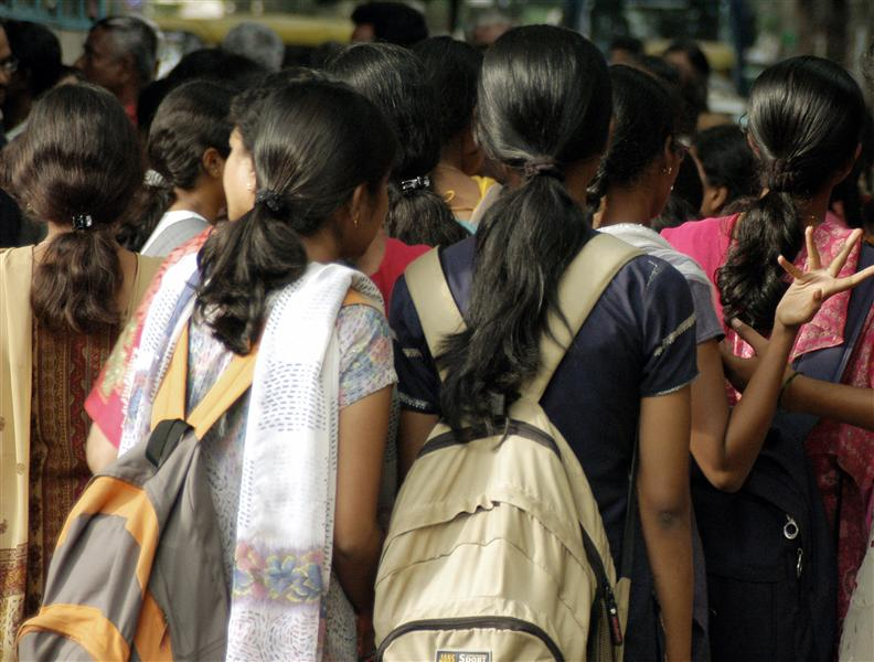 Women stand at a crowded place in the southern Indian city of Bangalore October 9, 2006. Credit: Reuters/Jagadeesh Nv