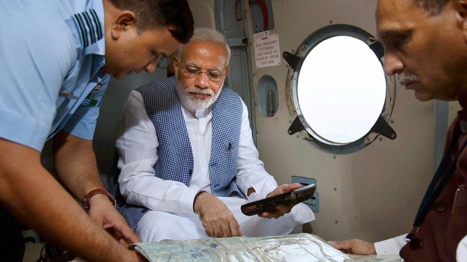 Prime Minister Narendra Modi with Gujarat chief minister Vijay Rupani during an aerial survey of flood-affected areas of Banaskatha district of Gujarat in July. Credit: PTI