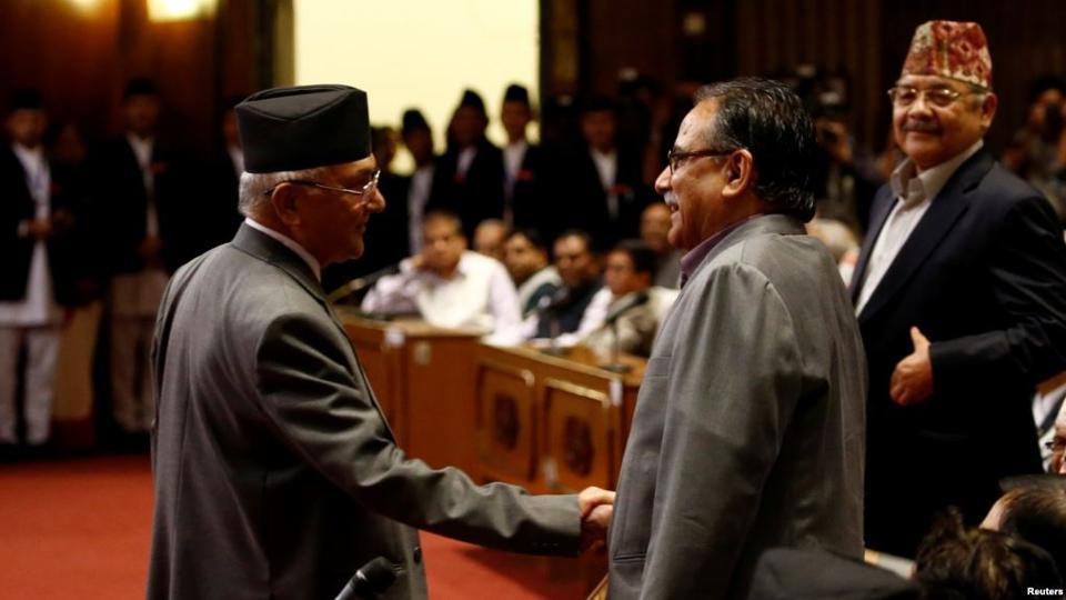 "UML leader K.P. Oli (left) shaking hands with CPN-Maoist Centre leader Pushpa Kamal Dahal ""Prachanda"". Credit: Reuters"
