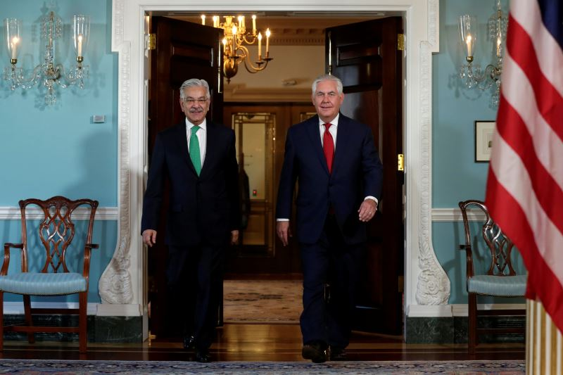 US Secretary of State Rex Tillerson (R) meets with Pakistan's Foreign Minister Khawaja Muhammad Asif at the State Department in Washington, US, October 4, 2017. Credit: Reuters/Yuri Gripas