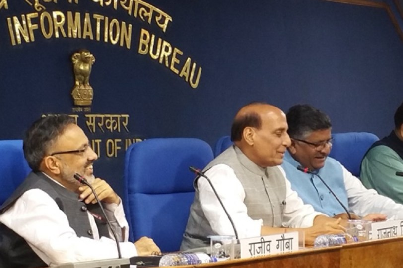 Union home minister Rajnath Singh (C) announcing Narendra Modi cabinet decisions on Wednesday. Union law minister Ravishankar Prasad (R) is also seen. Credit: PIB