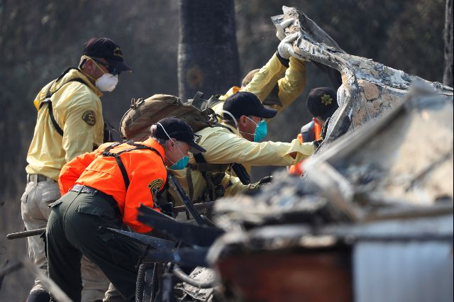 Search and Rescue teams search for two missing people amongst ruins at Journey's End Mobile Home Park destroyed by the Tubbs Fire in Santa Rosa, California. Credit: Reuters