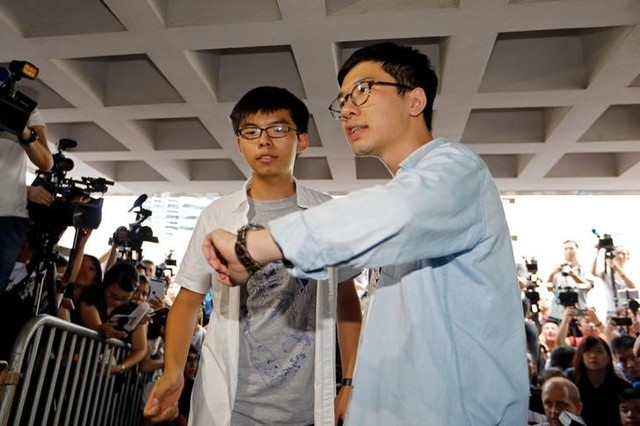 Student leaders Joshua Wong and Nathan Law arrive at the High Court to face verdict on charges relating to the 2014 pro-democracy Umbrella Movement, also known as Occupy Central protests, in Hong Kong, China August 17, 2017. Credit: Reuters