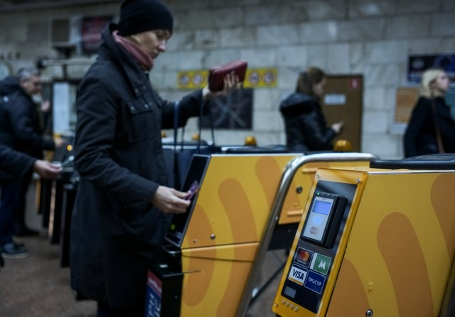 A passenger swipes a card against a terminal to ride the subway system in Kiev, Ukraine October 24, 2017. Credit: Reuters