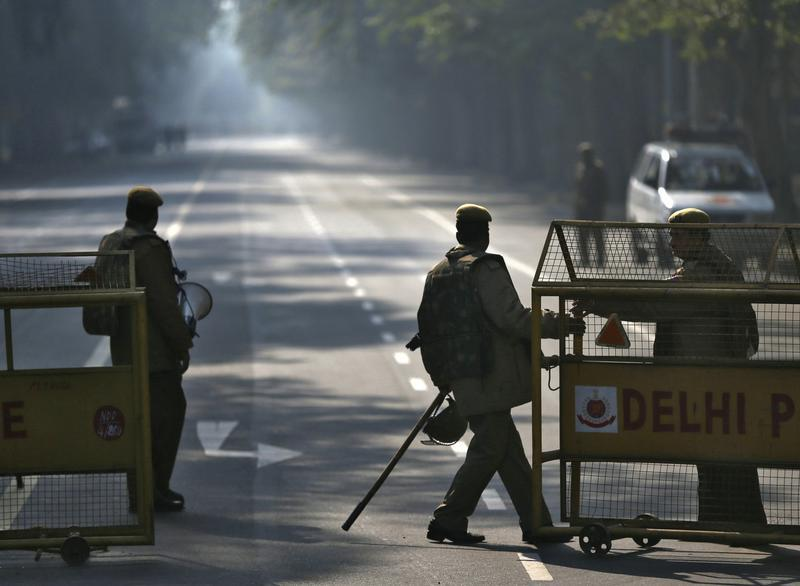 A police officer pulls a barricade to close a road leading to the India Gate in New Delhi December 29, 2012. Credit: Reuters/Ahmad Masood
