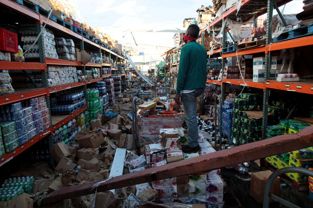 A man stands inside of a destroyed supermarket by Hurricane Maria in Salinas, Puerto Rico, September 29, 2017 Credit: Reuters