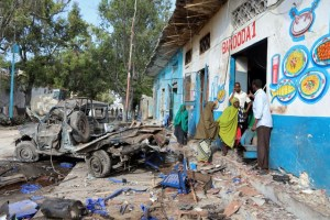 Residents gather at the scene of a suicide car bomb explosion, at the gate of Naso Hablod Two Hotel in Hamarweyne district of Mogadishu, Somalia October 29, 2017. Credit: Reuters