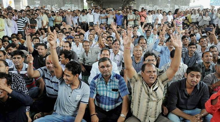 Textile traders chant slogans during a protest against GST in Surat. Credit: PTI