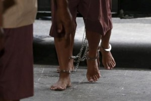 The shackled legs of suspected human traffickers are seen as they arrive for their trial at the criminal court in Bangkok, Thailand, March 15, 2016. Credit: Reuters