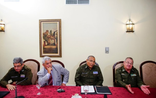 A team investigating U.S. complaints of attacks on diplomats in Havana, lead by Cuban Interior Ministry's Colonel Ramiro Ramirez (R), participate in an interview at the Hotel Nacional in Havana, Cuba, October 22, 2017. Credit: Reuters