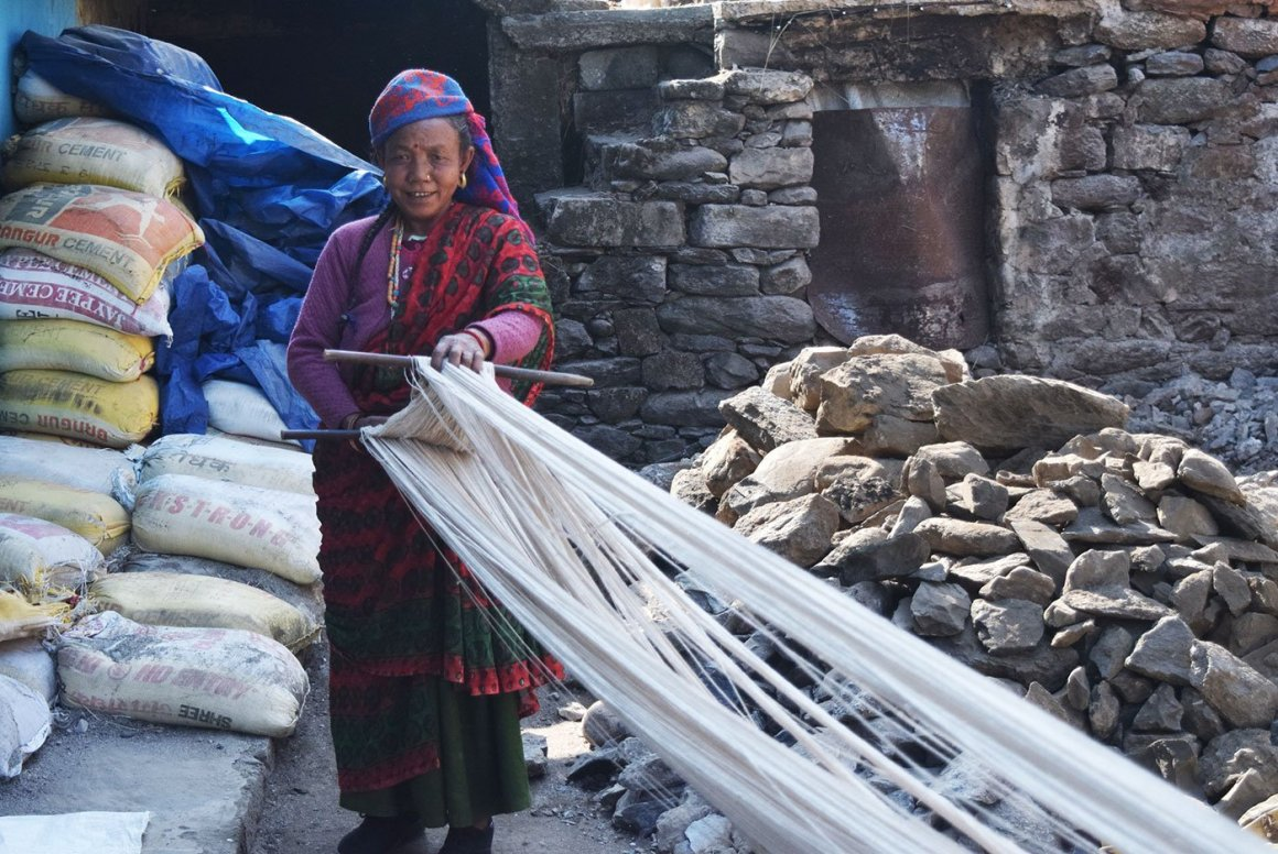 uppu Devi with the yarn she uses to make a chutkha, a thick blanket which can last up to a hundred years. Credit: Arpita Chakrabarty