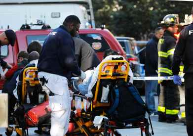 First responders tend to a victim after a shooting incident in New York City, U.S. October 31, 2017.
