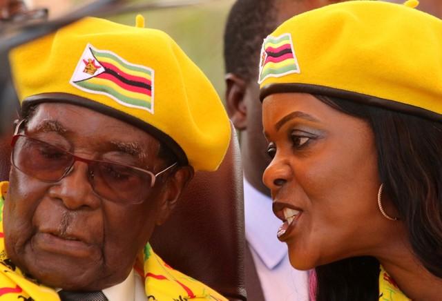 President Robert Mugabe listens to his wife Grace Mugabe at a rally of his ruling ZANU-PF party in Harare, Zimbabwe, November 8, 2017. Credit: Reuters/Philimon Bulawayo/Files