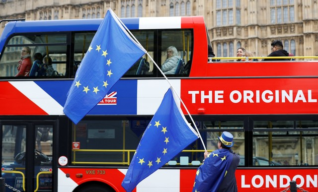 A tourist bus passes an anti Brexit protester in London, Britain October 19, 2017. Credit: Reuters/Peter Nicholls