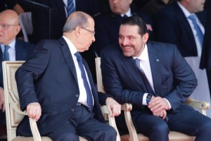 Saad al-Hariri, who announced his resignation as Lebanon's prime minister from Saudi Arabia reacts as he talks with Lebanese President Michel Aoun while attending a military parade to celebrate the 74th anniversary of Lebanon's independence in downtown Beirut, Lebanon November 22, 2017. Credit: Reuters/Mohamed Azakir