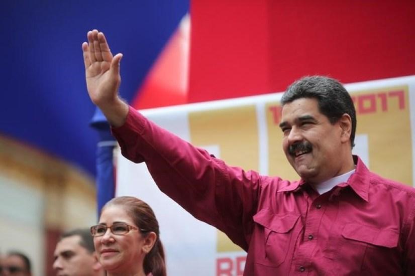 Venezuela's President Nicolas Maduro waves as he arrives for a rally with supporters in Caracas, Venezuela November 7, 2017. Miraflores Palace/Handout via Reuters