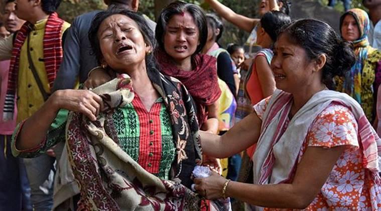 Evictees at Amchang. Credit: Reuters