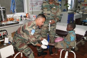 Indian military doctors attend to a child in Kiwanja, the Democratic Republic of Congo via The Blue Berets. CC BY-SA 2.0