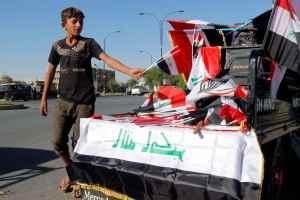 A boy sells Iraqi flags on a street in Kirkuk, Iraq, October 19, 2017. Credit: Reuters