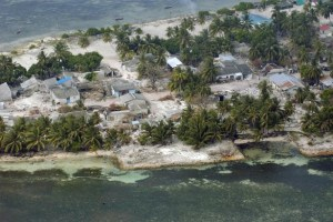 An aerial view of the Village of Kolhuvaariyaafushi, Mulaaku Atoll, the Maldives, after the Indian Ocean Tsunami. Credit: UN Credit/Evan Schneider