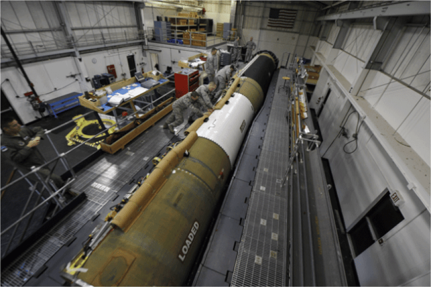 US Air Force airmen install a cable raceway on an intercontinental ballistic missile at Vandenberg Air Force Base in California on February 3, 2014. Credit: (US Air Force photo by Staff Sgt. Jonathan Snyder)