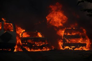 Cars burn along with a home during the Lilac Fire, a fast moving wild fire in Bonsall, California, US, December 7, 2017. Credit: Reuters/Mike Blake