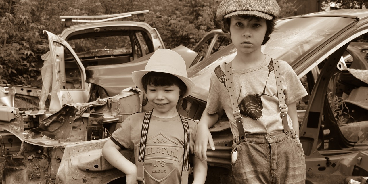 Two boys in a junkyard — 7 YouTube Channels for Homeschoolers to Learn How to Fix Cars