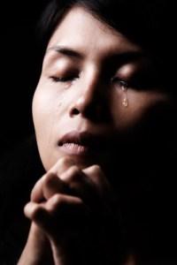 praying-crying-woman