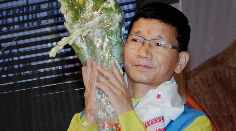 Guwahati: Arunachal Pradesh Chief Minister Kalikho Pul being felicitated at the inaugural conclave of North East Democratic Alliance (NEDA) at Sankardev Kalakshetra in Guwahati on Wednesday. PTI Photo (PTI7_13_2016_000115B)