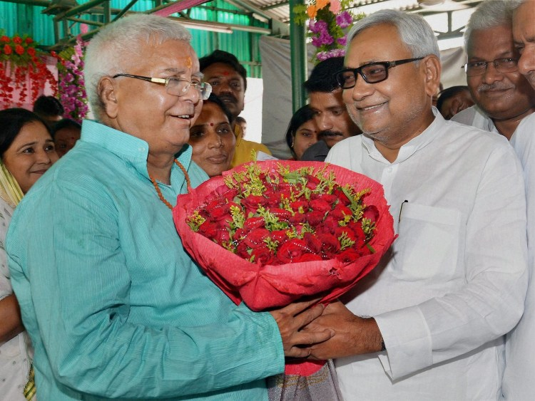 Patna: Bihar Chief Minister Nitish Kumar greeting RJD chief Lalu Prasad on his 68th birthday in Patna on Thursday. PTI Photo (PTI6_11_2015_000047A)